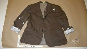 Lab analysis showed minute spots of blood found on this brown jacket -- owned by Dennis OIand -- that matched the DNA profile of Richard Oland. (Court exhibit)