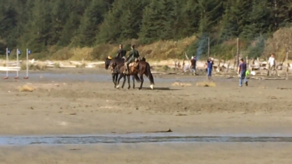 People on horseback are seen on Long Beach near Tofino, B.C., as crews film scenes for the sequel to 2014's popular 'Dawn of the Planet of the Apes.' Oct. 15, 2015. (CTV Vancouver Island)