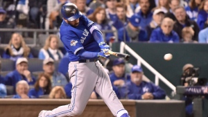 Toronto Blue Jays' Chris Colabello hits a single against the Kansas City Royals during fourth inning game 1 American League Championship Series baseball action in Kansas City, Mo. on Friday, Oct. 16, 2015. THE CANADIAN PRESS/Nathan Denette