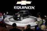 The 2016 Chevrolet Equinox is unveiled during the media preview of the Chicago Auto Show at McCormick Place in Chicago, on Thursday, Feb. 12, 2015. (AP/Andrew A. Nelles)