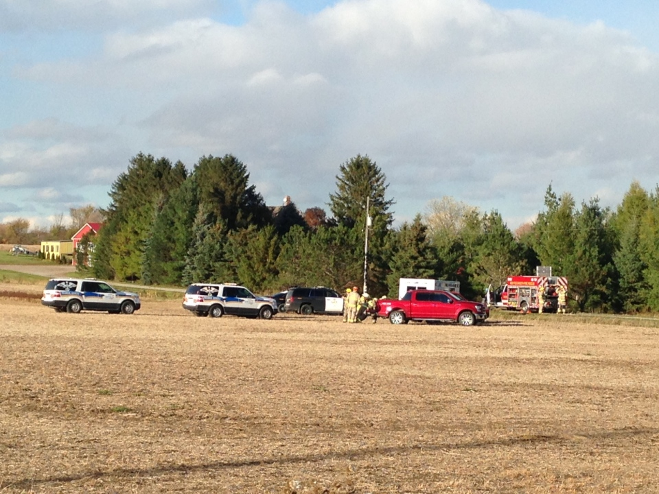 Emergency crews can be seen at the site of a plane crash in the area of 8th Line and Tottenham Road near Beeton, Ont. on Saturday, Oct. 17, 2015. (Steve Mansbridge/ CTV Barrie)