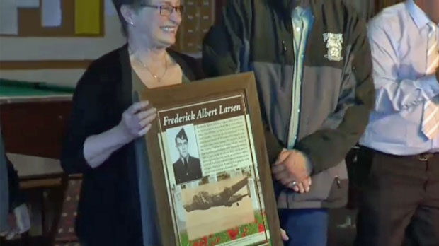 Wendy Cote holds the tribute to her father after the Royal Canadian Legion #284 gifted the piece to her