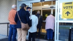 Voters line up to cast their ballots at a polling station in New Brunswick on Oct. 19, 2015.