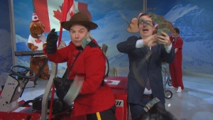 John Oliver and Mike Myers throw five thousand dollars of Canadian bills at the camera during a segment of an episode of 'Last Week Tonight.'