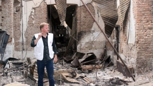 Christopher Stokes, the general director of the medical charity, Doctors Without Borders, which is also known by its French abbreviation MSF, stands amid the charred remains of the organization's hospital, after it was hit by a U.S. airstrike in Kunduz, Afghanistan in this photo on Friday, Oct. 16, 2015. (Najim Rahim via AP)