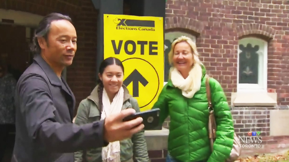 Elections Canada is cautioning Canadians to wait until they're outside the polling station to snap that selfie.