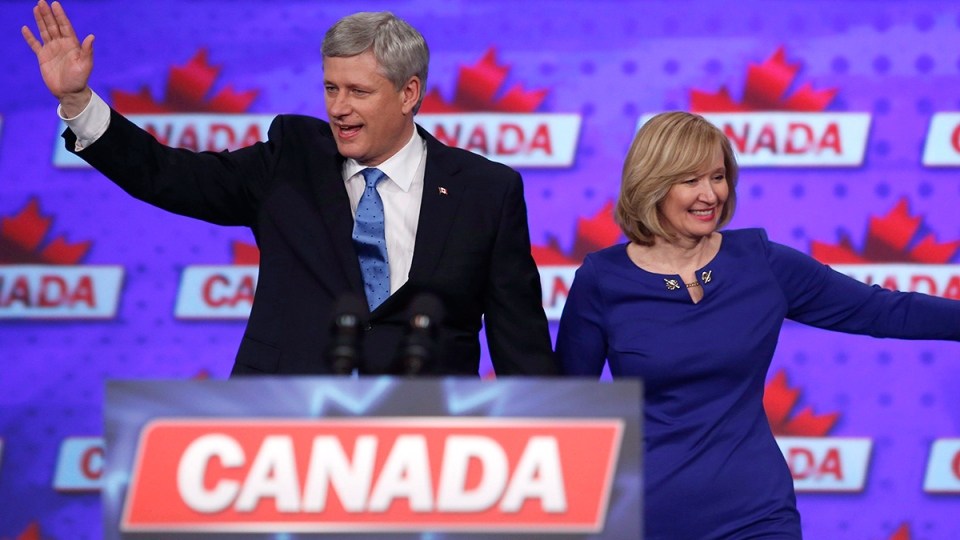 Conservative Leader Stephen Harper along with his wife Laureen wave to supporters in Calgary, Monday, Oct. 19, 2015. (Jeff McIntosh / THE CANADIAN PRESS)