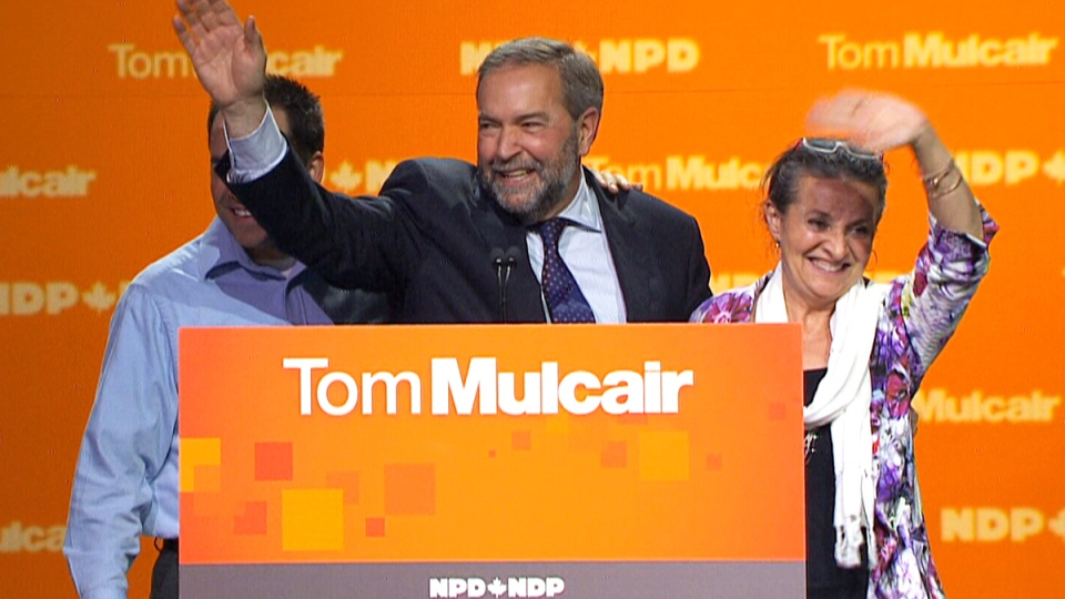 NDP Leader Tom Mulcair waves to supporters after speaking at NDP headquarters in Montreal, Monday, Oct. 19, 2015.