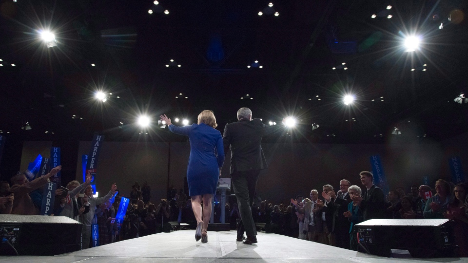 Conservative leader Stephen Harper and his wife Laureen make their way on stage on election night in Calgary on Monday Oct. 19, 2015. (Jonathan Hayward / THE CANADIAN PRESS)