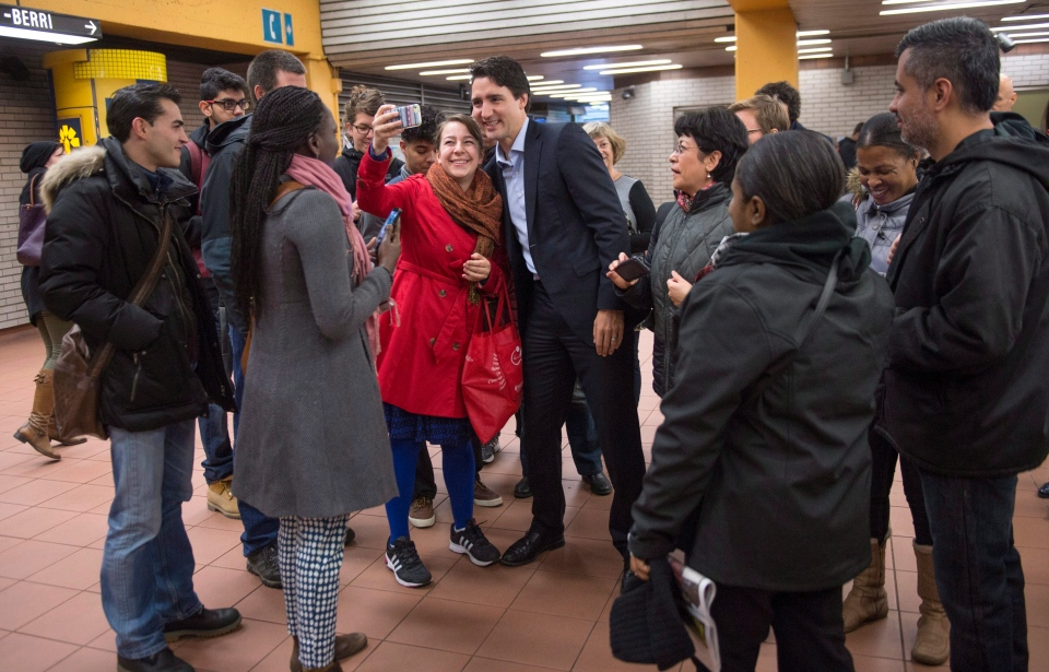 Prime Minister-designate Justin Trudeau greets constituents at a subway station in his riding in Montreal, Tuesday, Oct. 20, 2015. (Paul Chiasson / THE CANADIAN PRESS)