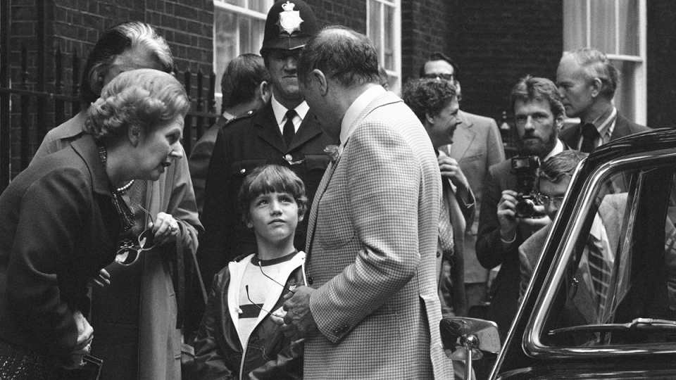 British Prime Minister Margaret Thatcher, left, Canadian Prime Minister Pierre Trudeau, centre, facing left, and his son Justin, 8, outside No. 10 Downing Street, in London, on June 25, 1980. (Lawrence Harris / AP)