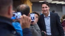 PM-designate Justin Trudeau poses for photos