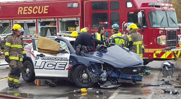 Firefighters work at the scene of a crash involving a Waterloo Regional Police cruiser at Morrison Road and Dundas Street in North Dumfries on Tuesday, Oct. 20, 2015. (Dave Ritchie)