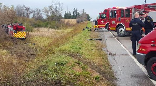 A fire truck rests in the ditch following a serious collision near Morrison Road and Dundas Street in North Dumfries on Tuesday, Oct. 20, 2015. (Dave Ritchie)