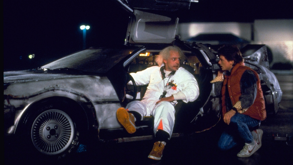 This photo provided by Universal Pictures Home Entertainment shows Christopher Lloyd, left, as Dr. Emmett Brown, and Michael J. Fox as Marty McFly in the 1985 film, 'Back to the Future.' (Universal Pictures Home Entertainment)