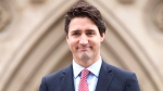 Prime minister designate Justin Trudeau walks to a news conference from Parliament Hill in Ottawa, Tuesday Oct. 20, 2015. (Adrian Wyld / THE CANADIAN PRESS)