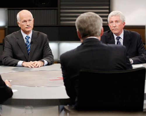 NDP Leader Jack Layton and Bloc Quebecois Leader Gilles Duceppe listen to Prime Minister Stephen Harper during the English language election debate in Ottawa, on Thursday, Oct. 2, 2008. (Tom Hanson / THE CANADIAN PRESS)