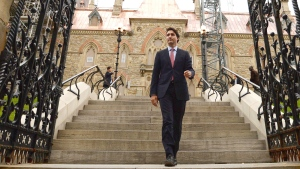 Prime minister designate Justin Trudeau makes his way from Parliament Hill to the National Press Theatre to hold a press conference in Ottawa on Tuesday, October 20, 2015. (Sean Kilpatrick / THE CANADIAN PRESS)