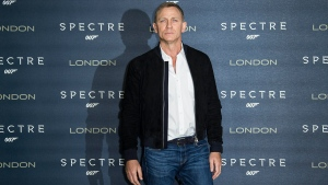 Daniel Craig poses for photographers during the photo call for the latest Bond film, Spectre, at an hotel in central London, Thursday, Oct. 22, 2015. (Joel Ryan / Invision)