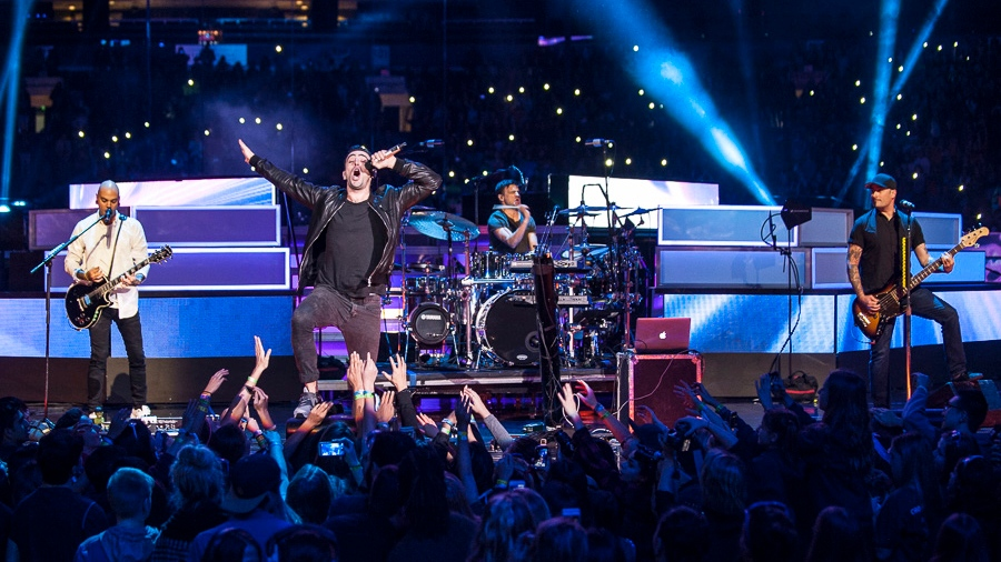 Hedley is seen performing at We Day 2015 at the Rogers Arena in Vancouver. (Anil Sharma, Julia Lof, and Kaja Bakken).