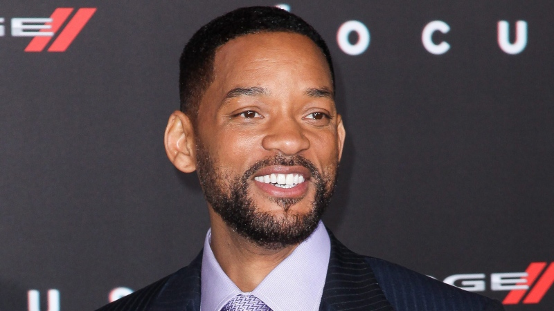 """In this Feb. 24, 2015 file photo, Will Smith arrives at the world premiere of """"Focus"""" in Los Angeles. (Photo by John Salangsang/Invision/AP, FIle)"""
