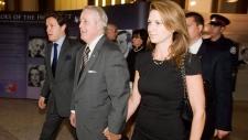 From left: Mark, Brian, and Caroline Mulroney