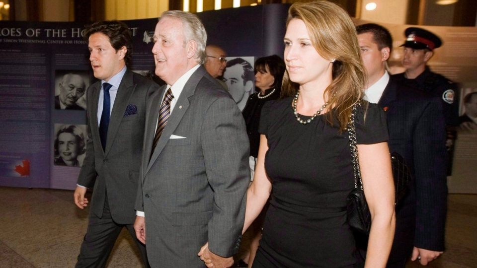 Former prime minister Brian Mulroney, second from left, with his son Mark, left, and daughter Caroline in Toronto, on May 31, 2010. (Darren Calabrese / CP)
