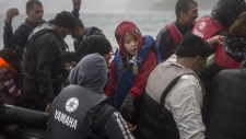 Refugees arrive on a dinghy in Greece