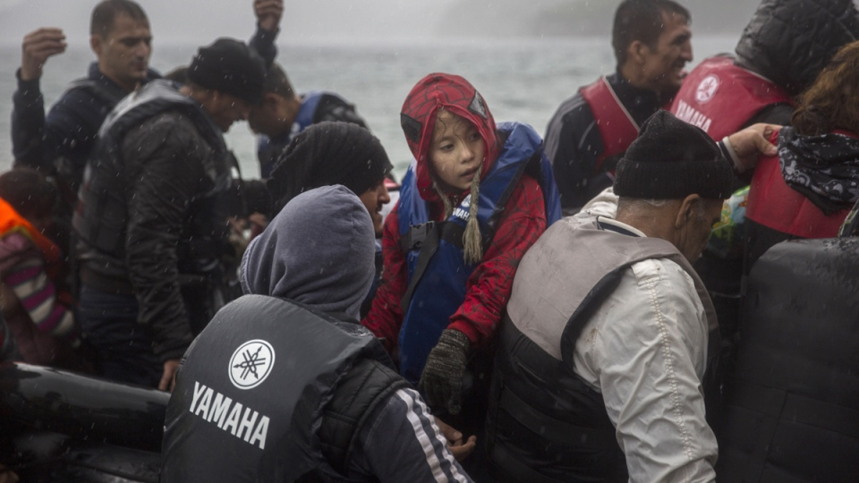 Refugees arrive on a dinghy from the Turkish coast at Skala Sikaminias village on the northeastern Greek island of Lesbos, Thursday, Oct. 22, 2015. (AP / Santi Palacios)