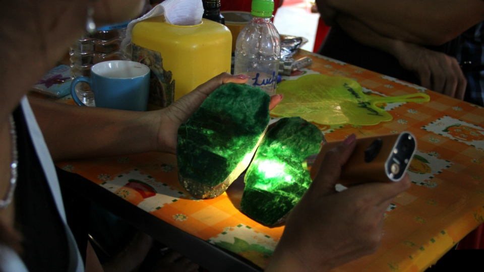 Local people examine the quality of a jade stone in the Hpakant area of Kachin state, northern Myanmar on Sept. 18, 2015 photo. (AP / Esther Htsusan)