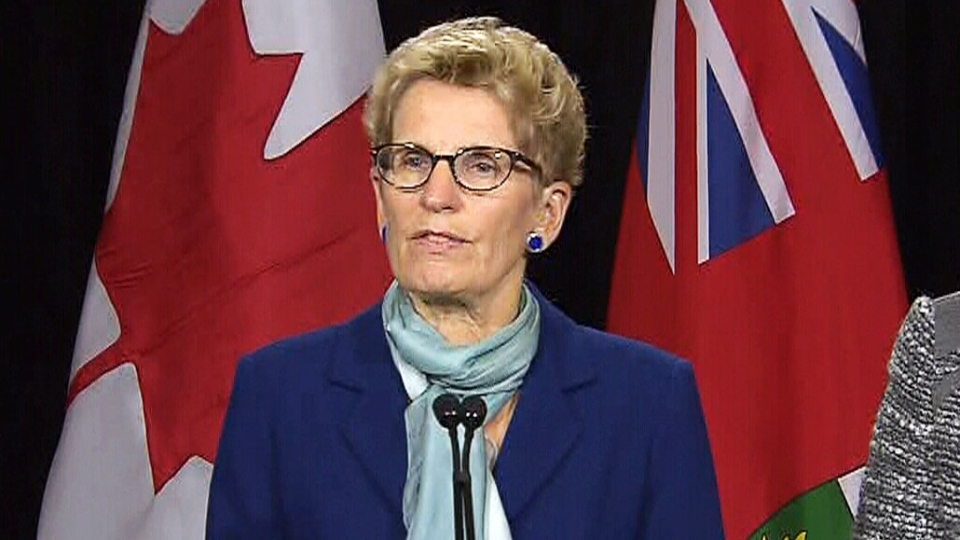 Ontario Premier Kathleen Wynne speaks to reporters after meeting with education labour groups on Friday, Oct. 23, 2015.