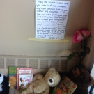 A touching note is posted above a tribute inside an apartment building for a six-year-old who was stabbed in London, Ont., Friday, Oct. 23, 2015.