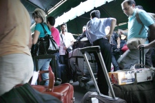 Foreign tourists wait in a queue along with thousands of others for a flight out of Thailand at the U-Tapao airport about 100 miles (160 km) south of Bangkok on Monday, Dec. 1, 2008. (AP / Ed Wray)
