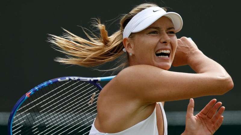 In this July 3, 2015, file photo, Maria Sharapova returns a ball to Irina-Camelia Begu during their singles match at the All England Lawn Tennis Championships in Wimbledon, London.  (AP/Pavel Golovkin, File)