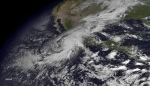 This satellite image taken at 10:45 a.m. EDT on Friday, Oct. 23, 2015, and released by the National Oceanic and Atmospheric Administration shows Hurricane Patricia moving over Mexico's Pacific Coast. (NOAA via AP)