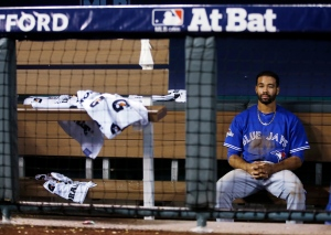 Toronto Blue Jays center fielder Dalton Pompey sits in the dugout after 4-3 loss against the Kansas City Royals in Game 6 of baseball's American League Championship Series on Friday, Oct. 23, 2015. (AP / Matt Slocum)