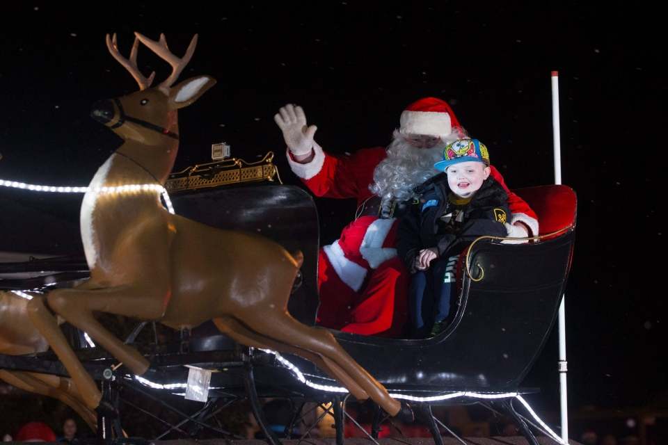 Evan Leversage rides in sleigh at a Christmas Parade in St. George, Ontario on Saturday October 24, 2015. (Chris Young / THE CANADIAN PRESS)