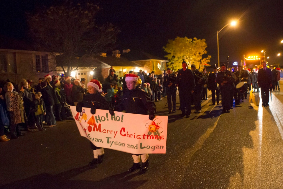 Participants join a Christmas Parade in honour of Evan Leversage in St. George, Ontario on Saturday October 24, 2015. (Chris Young / THE CANADIAN PRESS)