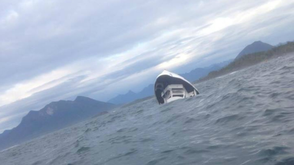 A boat carrying 27 people sank off the coast of Tofino, B.C., with one witness posting this photo of the scene on Sunday, Oct. 25, 2015. (Albert Titian / Facebook)