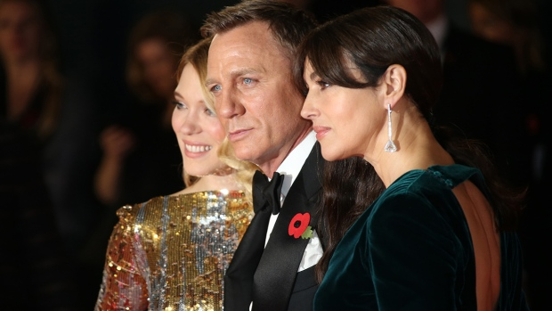 "Lea Seydoux, from left, Daniel Craig and Monica Bellucci pose for photographers upon arrival for the World Premiere of ""Spectre"" at the Royal Albert Hall in central London on Monday, Oct. 26, 2015. (Joel Ryan / Invision / AP)"