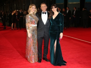 Lea Seydoux, from left, Daniel Craig and Monica Bellucci pose for photographers upon arrival for the World Premiere of 'Spectre' at the Royal Albert Hall in London on Monday, Oct. 26, 2015. (Joel Ryan / Invision / AP)