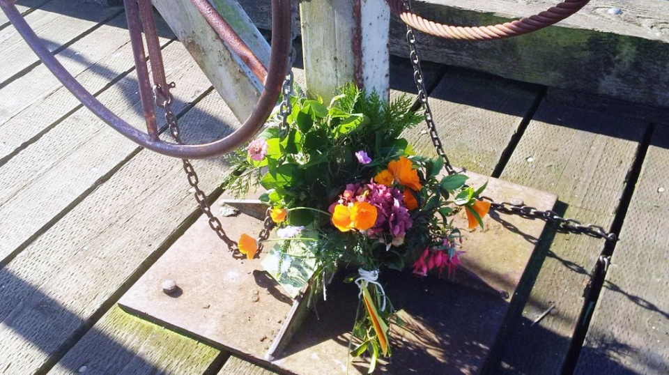 A memorial has been set up on the dock in Tofino to honour the five people who died in a whale watching cruise. (Janet Dirks / CTV News)