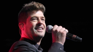 Robin Thicke performs during the Steve Harvey Morning Show live broadcast at the Georgia World Congress Center in Atlanta on Aug. 7, 2015. (Robb D. Cohen / Invision)