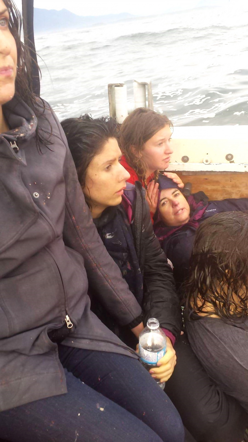 Survivors are rescued from the whale-watching boat Leviathan II, Sunday, Oct. 26, 2015 (Ken Brown)