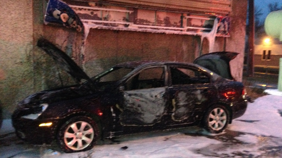 Flames caused severe damage to a vehicle outside an auto-body shop near Dufferin Avenue and Salter Street Tuesday morning