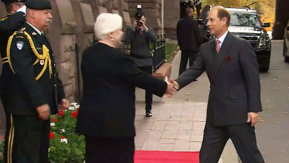 Prince Edward greets Ontario's Lieutenant Governor, Elizabeth Dowdeswell, in Toronto on Tuesday, Oct. 27, 2015.