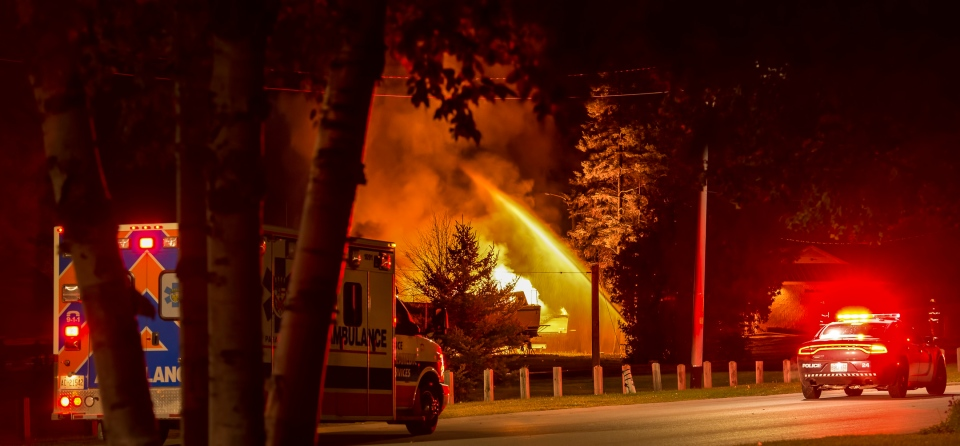 Firefighters battle a fire after an explosion at the Port Elgin Harbour on Tuesday, Oct. 27, 2015. (Michael Johnson Photography)