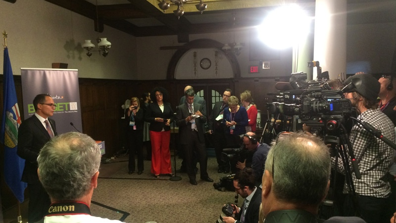 Finance Minister Joe Ceci takes questions from reporters on the 2015 budget.