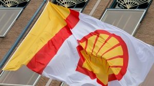 A flag bears the logo of Royal Dutch Shell outside the head office in The Hague, Netherlands, on Monday, April 7, 2014. (AP Photo/Peter Dejong)