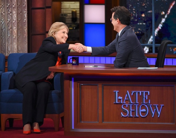 In this image released by CBS, Democratic Presidential candidate Hillary Clinton, left, shakes hands with host Stephen Colbert during a taping of 'The Late Show with Stephen Colbert,' Tuesday Oct. 27, 2015, in New York. (Jeffrey R. Staab/CBS via AP)
